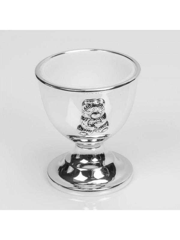 Зашеметяващ посребрен комплект от пръстен за салфетки, малка чаша и лъжичка.
